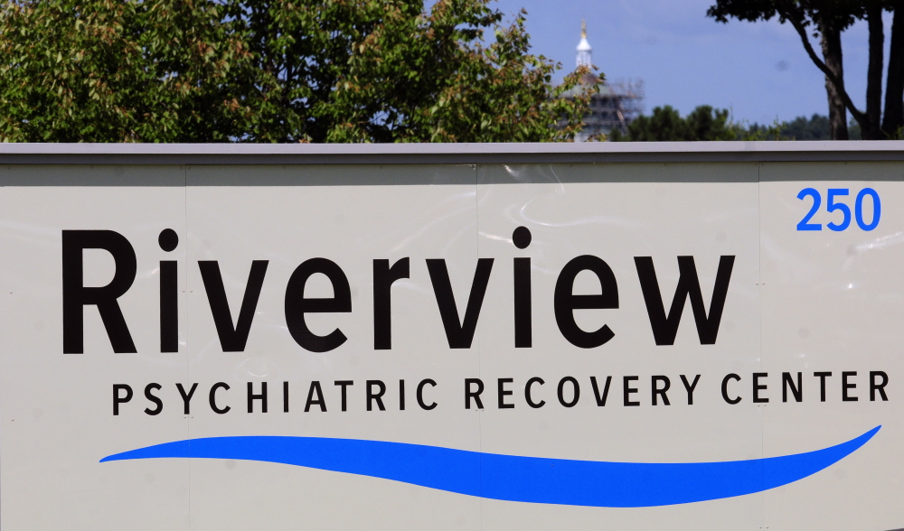 The State House dome across the Kennebec River can be seen behind the new sign reading Riverview Psychiatric Recovery Center in front of the Riverview Psychiatric Center.