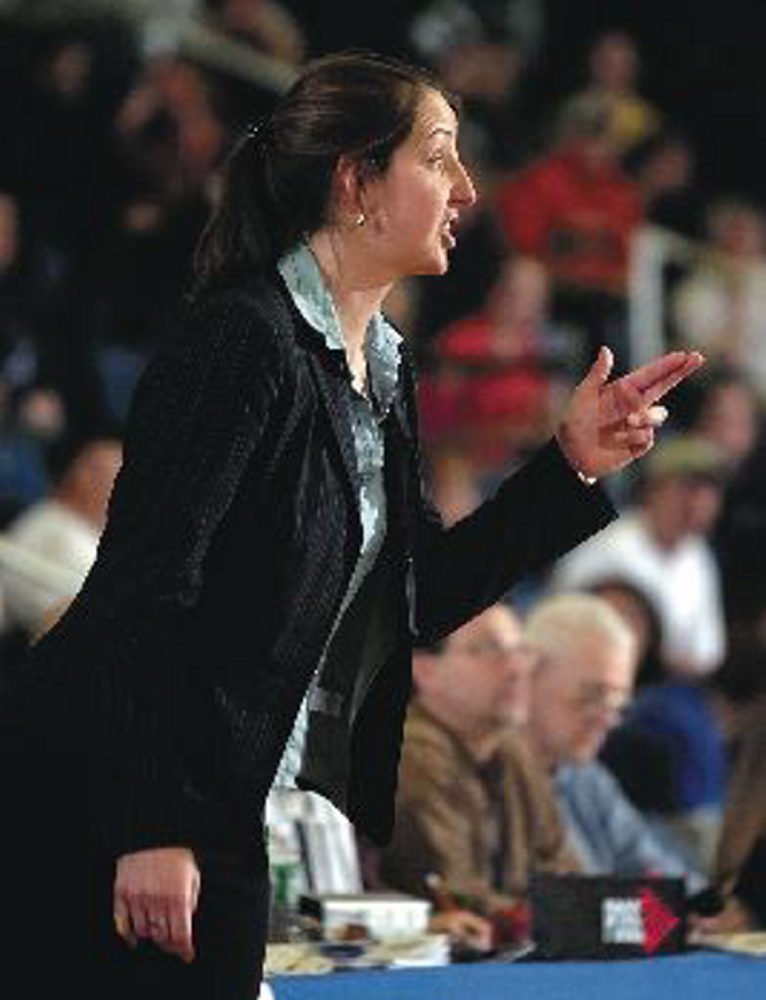 File photo Molly Bishop resigned as athletic director and girls basketball coach at Richmond High School to become the new athletic director in the Oceanside school district.