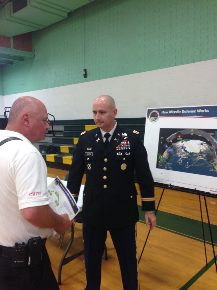 Plain Text:Rangeley Fire Chief Tim Pellerin, left, speaks with Lt. Col. Dan Martin at a public meeting on the potential environmental effect of construction of a missile interceptor facility in Redington Township.