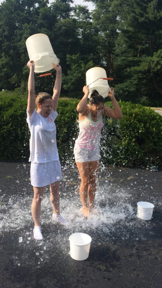 Jillian St. Louis and, at right, Danna Vaughn take the ice bucket challenge.