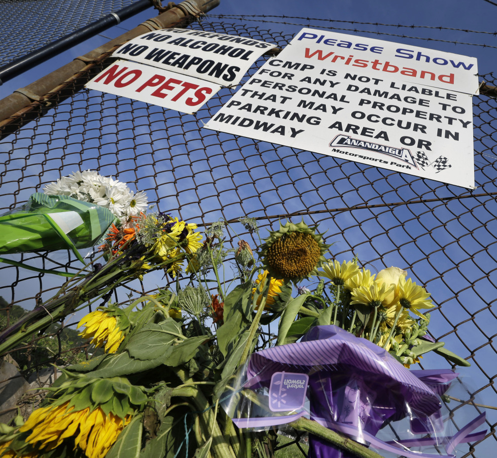 "The Associated Press A small memorial of flowers is seen at Canandaigua Motorsports Park Monday, Aug. 11, 2014, in Canandaigua, N.Y. On Saturday night, Tony Stewart struck and killed Kevin Ward Jr., 20, a sprint car driver who had climbed from his car and was on the track trying to confront Stewart during a race at the track in upstate New York. Ontario County Sheriff Philip Povero said his department's investigation is not criminal and that Stewart was ""fully cooperative"" and appeared ""very upset"" over what had happened. (AP Photo/Mel Evans)"