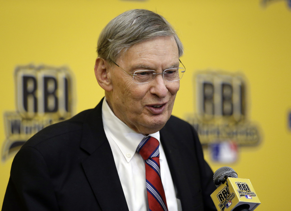 "The Associated Press Baseball Commissioner Allan H. ""Bud"" Selig smiles as he responds to a question from reporters after addressing participants of the 2014 Reviving Baseball in Inner Cities World Series during a luncheon, Aug. 6, 2014, in Grapevine, Texas."