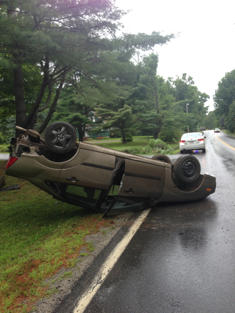 Jacob Collins, 19, of Sidney suffered a possible concussion when his car flipped over on West River Road in Sidney on Wednesday afternoon.