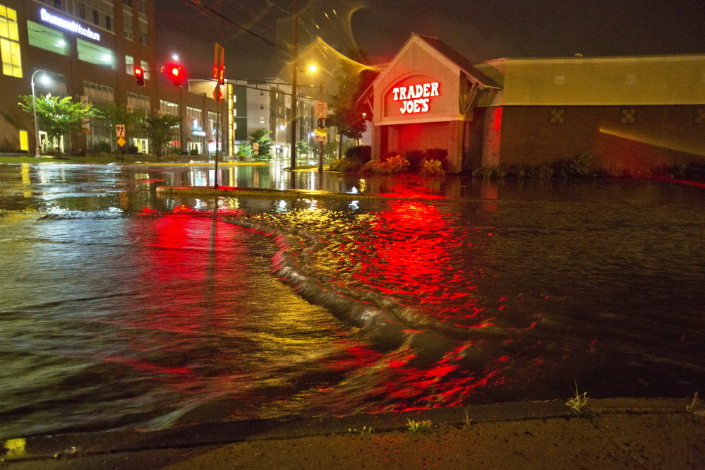Floodwaters engulf Preble Street late Wednesday night near the Trader Joe's store on Marginal Way in Portland. Marginal Way had to be closed overnight, but by Thursday morning it was reopened to traffic.