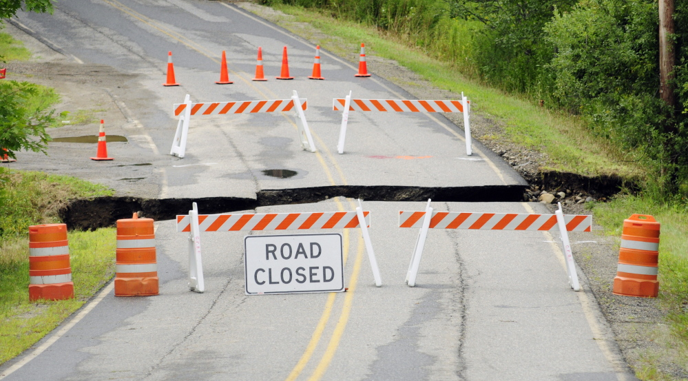 Heavy rains washed out a section of Town House Road on Thursday in Chelsea. There was over three inches of rainfall over night in many parts of central Maine.