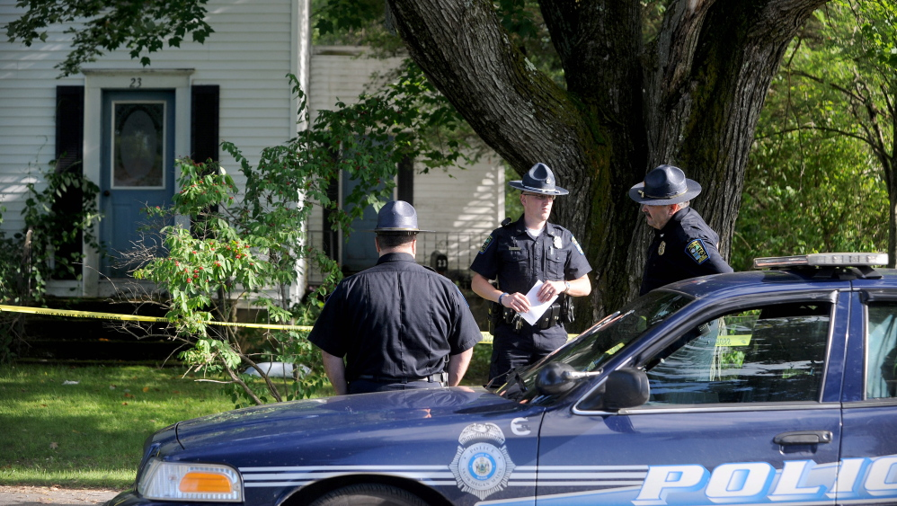 Skowhegan police officers stand outside 23 Chestnut St. after resident Wayne Shaw was seriously injured by another man, police said on Thursday.