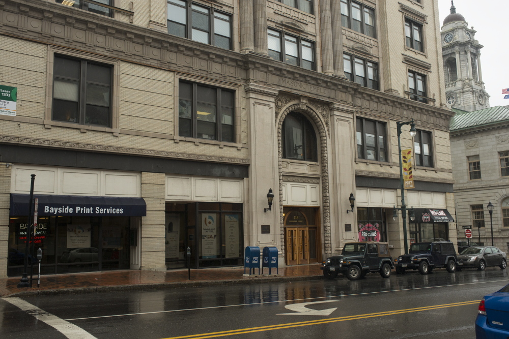The front half of the Masonic Temple on Congress Street in Portland, shown Wednesday, will be auctioned off this fall. It offers nearly 50,000 square feet of commercial office and retail space.