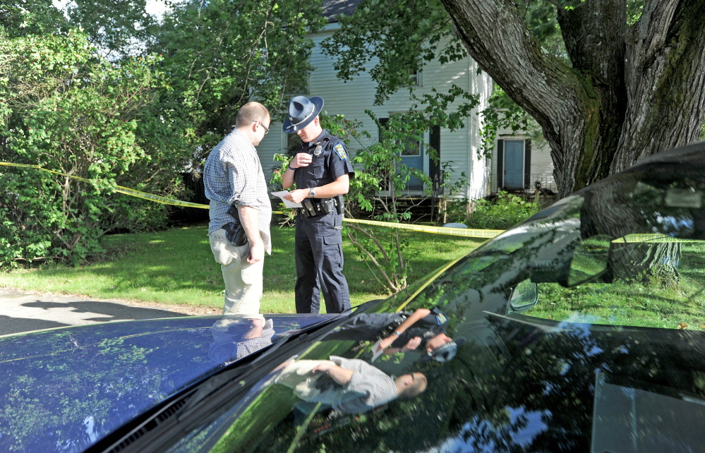 Skowhegan police officers stand outside 23 Chestnut St. after resident Wayne Shaw was seriously injured by another man on Thursday, police said.
