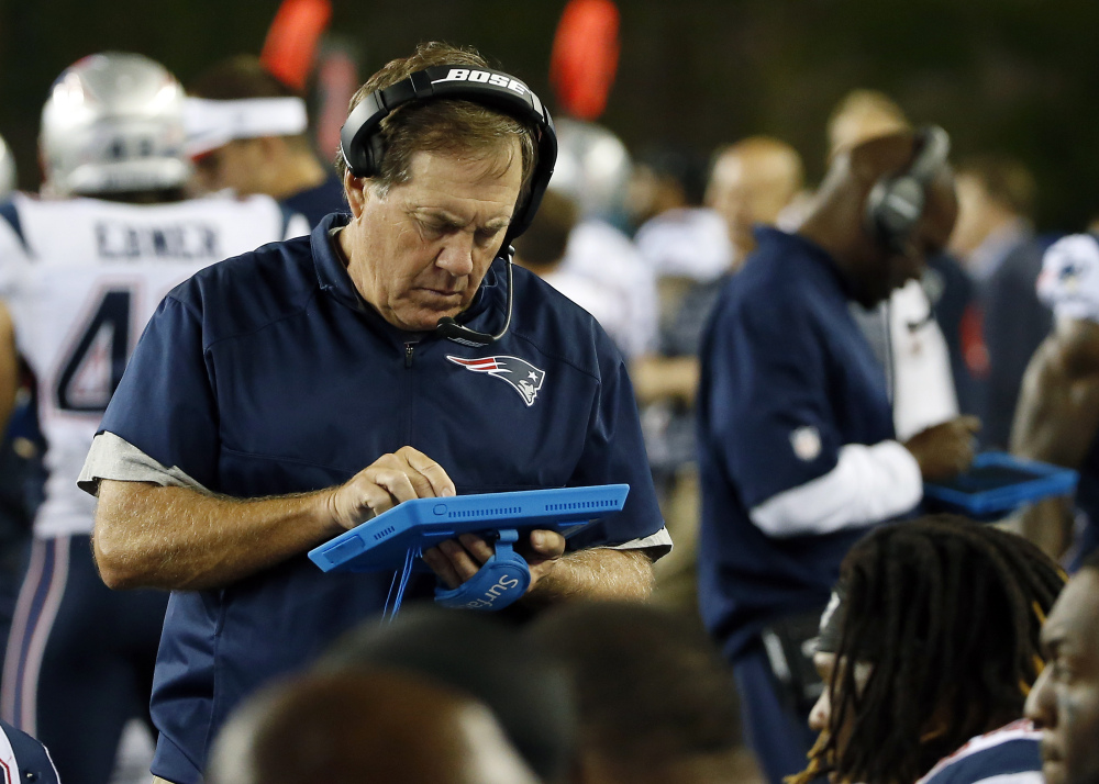 Patriots Coach Bill Belichick, who is using a tablet on the sideline in Friday's game against the Philadelphia Eagles, was penalized for unsportsmanlike conduct for arguing, in vain, against a penalty on the Eagles.