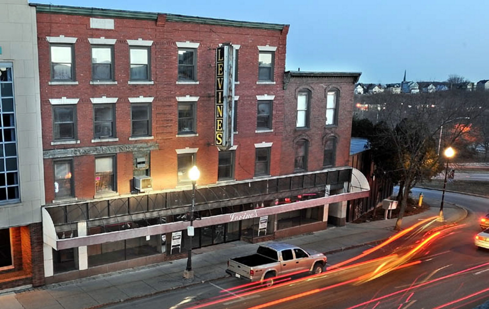 The Levine's building on Maine Street in Waterville was slated to be redeveloped, but those plans now are on hold.