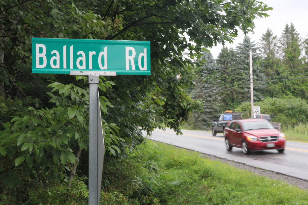 Motorists on Old Belgrade Road in Augusta drive past Ballard Road on Friday. The City Council is considering a proposal to change the name of the road to Jeff Gagnon Road. Gagnon, who grew up on the road, was murdered in 1989.