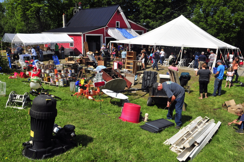 An auction to raise money for a new fire station was held under a tent in front of the station during the Coopers Mills Volunteer Fire Department charity auction on Saturday.