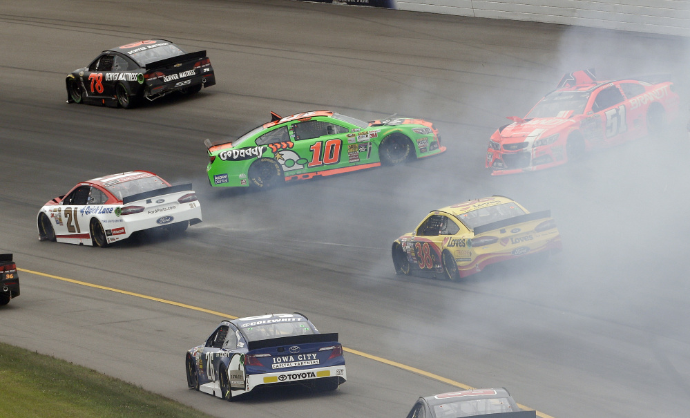 Danica Patrick (10) slides into turn two during the NASCAR Sprint Cup Series Pure Michigan 400 auto race at Michigan International Speedway in Brooklyn, Mich., Sunday.