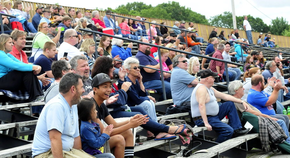 Staff photo by David Leaming Spectators clap for winners of a race at the Unity Raceway in Unity on Sunday.