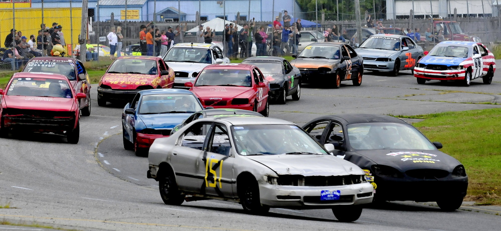 Racers negotiate a turn at the Unity Raceway on Sunday. Racing has returned to the track, which sat idle for much of the summer while the owners looked for a new general manager.