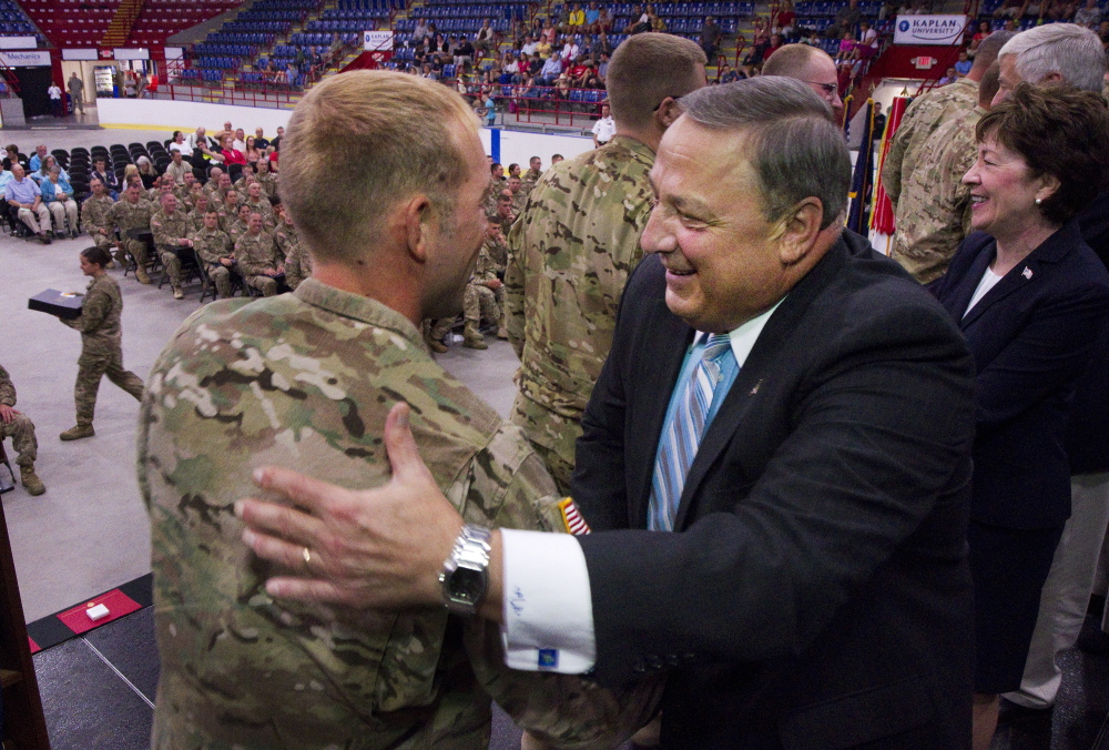 Maine Governor Paul Lepage thanks members of Maine's 133rd Engineer Battalion, recently back from deployment in Afghanastan, during a ceremony at the Colisee in Lewiston on Sunday.