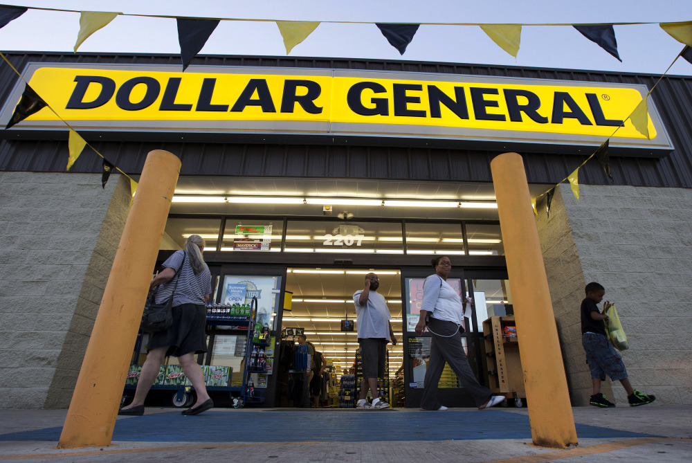 In this Wednesday, Sept. 25, 2013, file photo, customers exit a Dollar General store, in San Antonio.