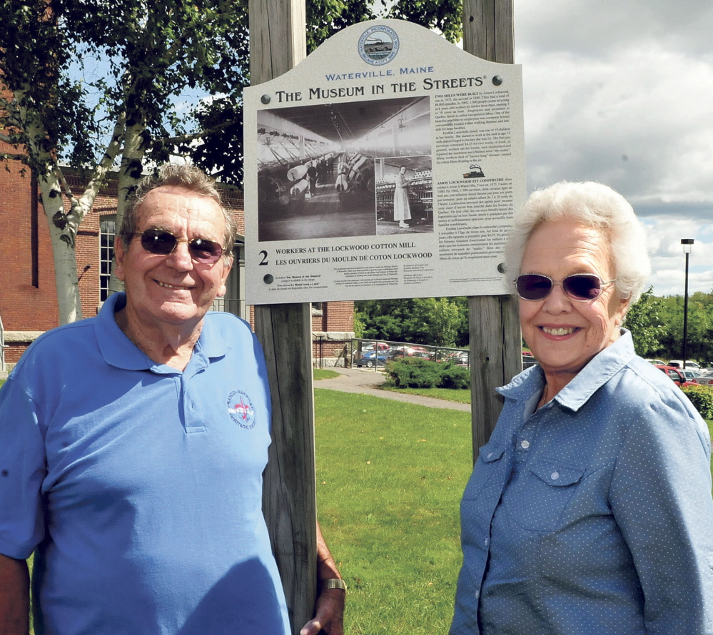 Perley and Alice Lachance, at a Museum in the Streets sign near the Hathaway Center in Waterville on Monday, have been involved with the annual Franco-American Festival since its inception 12 years ago. The festival has been re-named Festival at the Falls and will include a variety of ethnic music and foods and will be held at Head of Falls in Waterville on September 6.