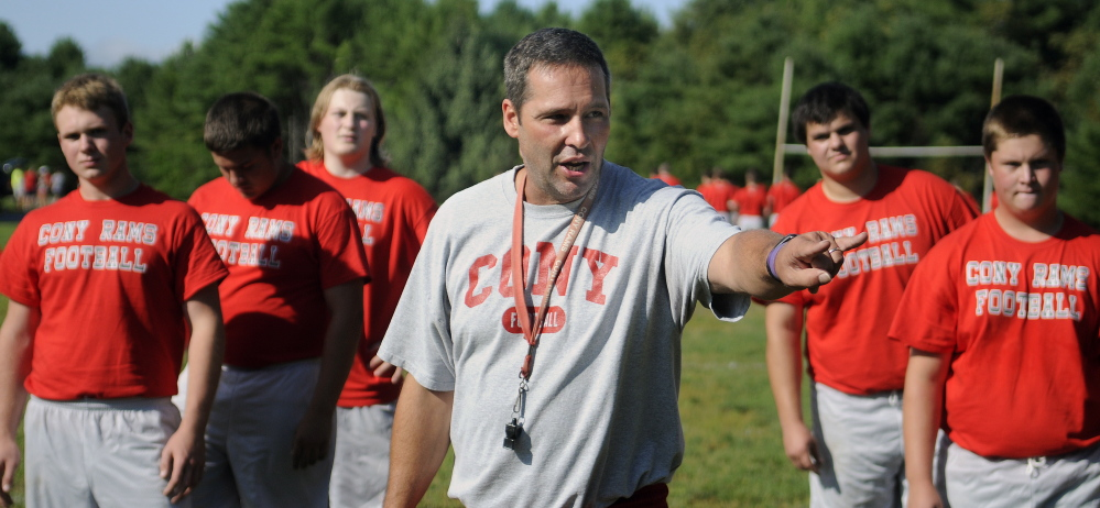 Cony High School football coach Robby Vachon oversees a drill during the first practice of the season Monday.