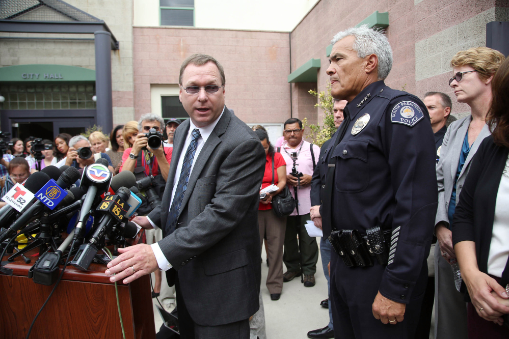South Pasadena, Calif., Police Chief Arthur Miller, right, and South Pasadena Unified School District Superintendent Dr. Geoff Yanz announce Tuesday that police had arrested two South Pasadena High School students suspected of planning a massacre at the school.