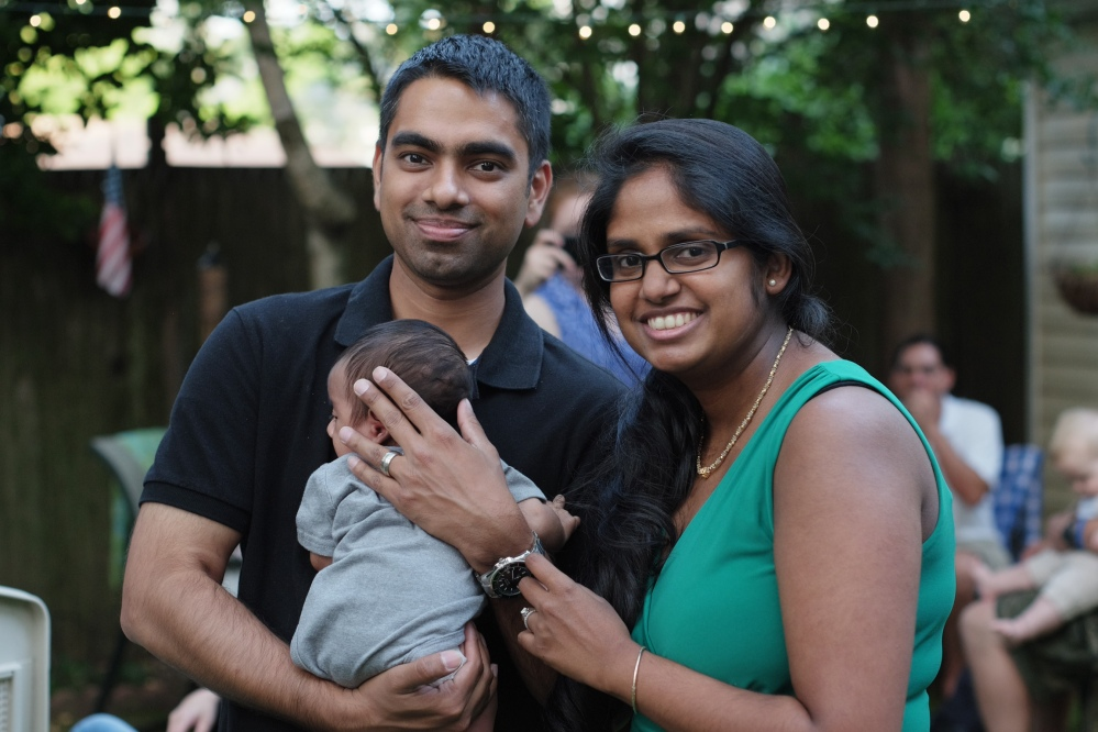 Wasim Ahmad and his wife, Lakshmi Ramsoondar-Ahmad, pose with their newborn son in Merrick, N.Y. Two days after his son was born, Ahmad bought the website domain with his son's name.