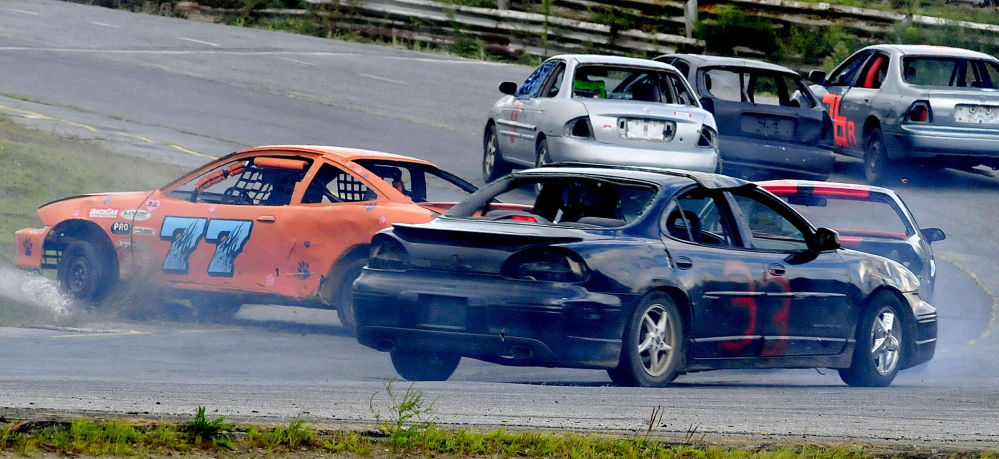 Car number 77 spins out at a turn during races at Unity Raceway on Sunday, Aug. 17, 2014. (Photo by David Leaming/Staff Photographer)