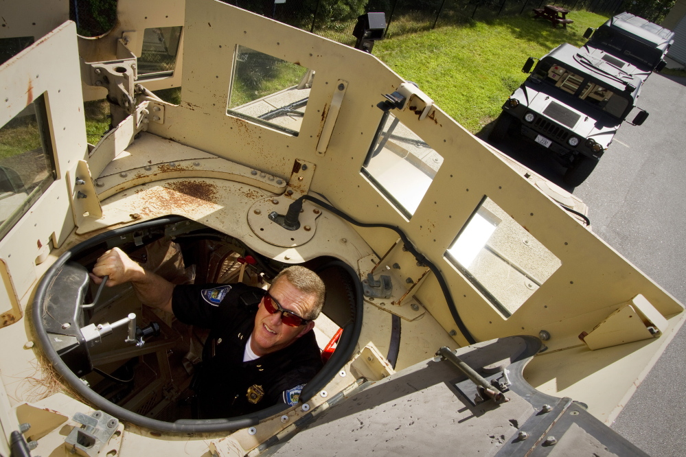 Sanford Police Chief Thomas Connolly looks through the roof hatch of his department's Mine-Resistant Ambush Protected (MRAP) vehicle on Tuesday in Sanford.