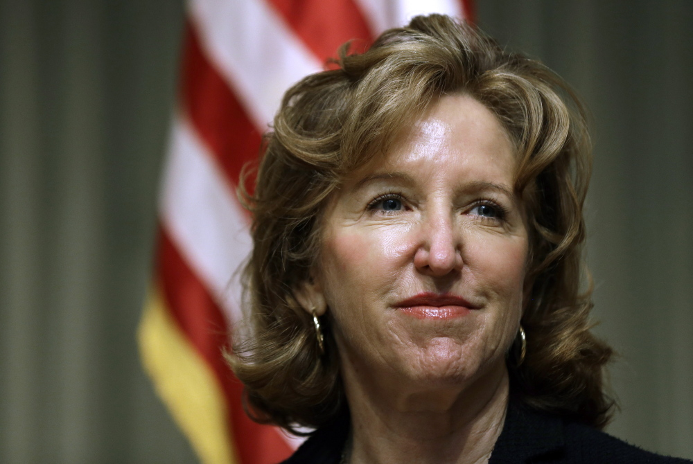 In this 2014 file photo, Sen. Kay Hagan, D-N.C., listens during an appearance in Durham, N.C. The Democratic Party's control of the U.S. Senate after the general election in November could lie in the fortunes of female candidates and the deep-pocketed donors, like former New York Mayor Michael Bloomberg, who are sending piles of cash their way. Hagan in North Carolina and Jeanne Shaheen in New Hampshire face heavy outside spending but have Emily's List backing.