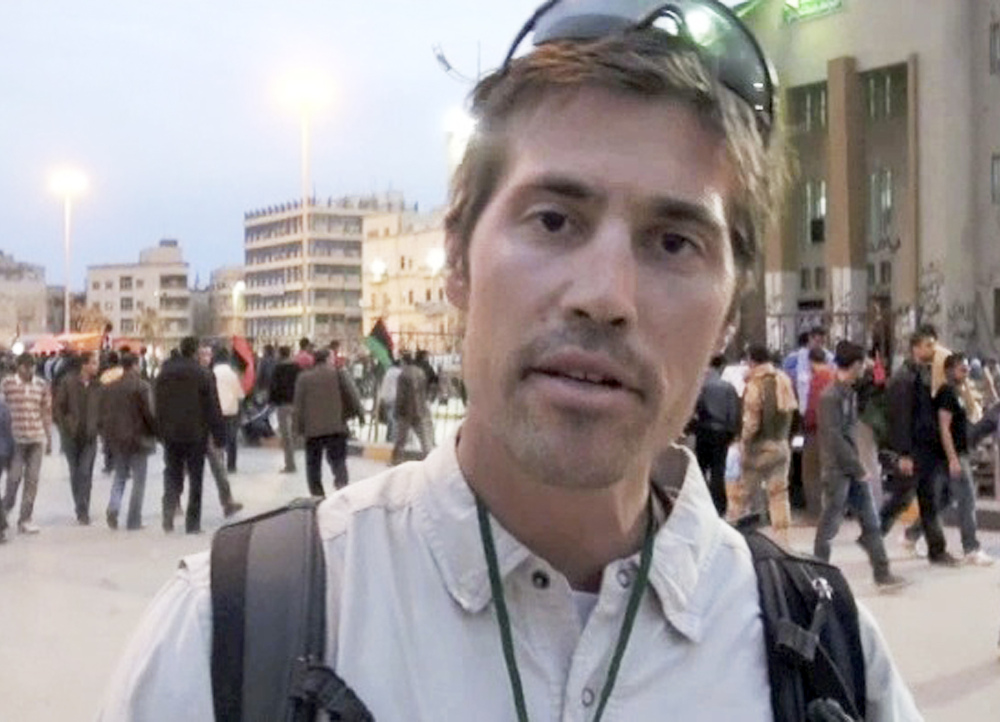 This undated still image from video released April 7, 2011, by GlobalPost, shows James Foley of Rochester, N.H., a freelance contributor for GlobalPost, in Benghazi, Libya. In a horrifying act of revenge for U.S. airstrikes in northern Iraq, militants with the Islamic State extremist group have beheaded Foley — and are threatening to kill another hostage, U.S. officials say.