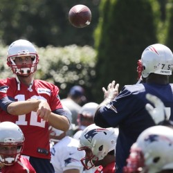 New England Patriots quarterback Tom Brady throws a pass to defensive tackle Vince Wilfork (75) during practice Wednesday in Foxborough, Mass.
