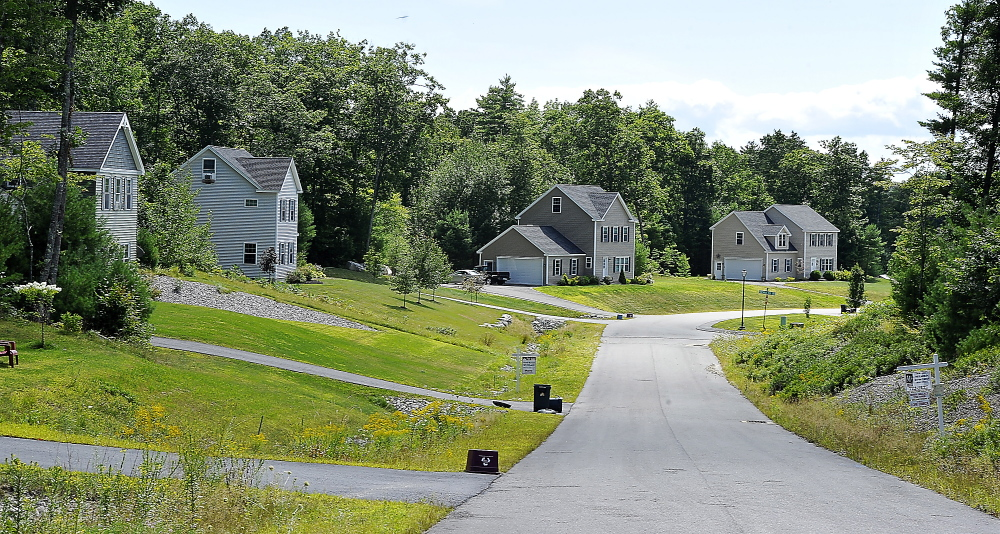 Homes stand on winding Thrush Terrace in Windham. Buyers can get more house for their money here than in nearby towns, and the demand for larger houses is growing.