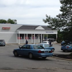 Police are seen outside of the Rite-Aid store at the corner of Spring and Ridge streets in Gardiner Thursday morning following a report of a robbery there.
