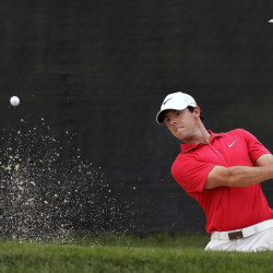 Rory McIlroy hits from a bunker on the 13th hole during the first round of play Thursday at The Barclays in Paramus, N.J.  McIlroy shot a 3-over 74, his worst start in two months.