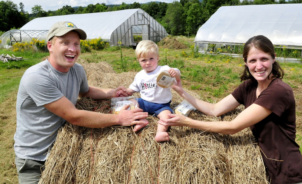 Andy and Sarah Marble and their son Avery at the Marble Family Farm in Farmington on Thursday.