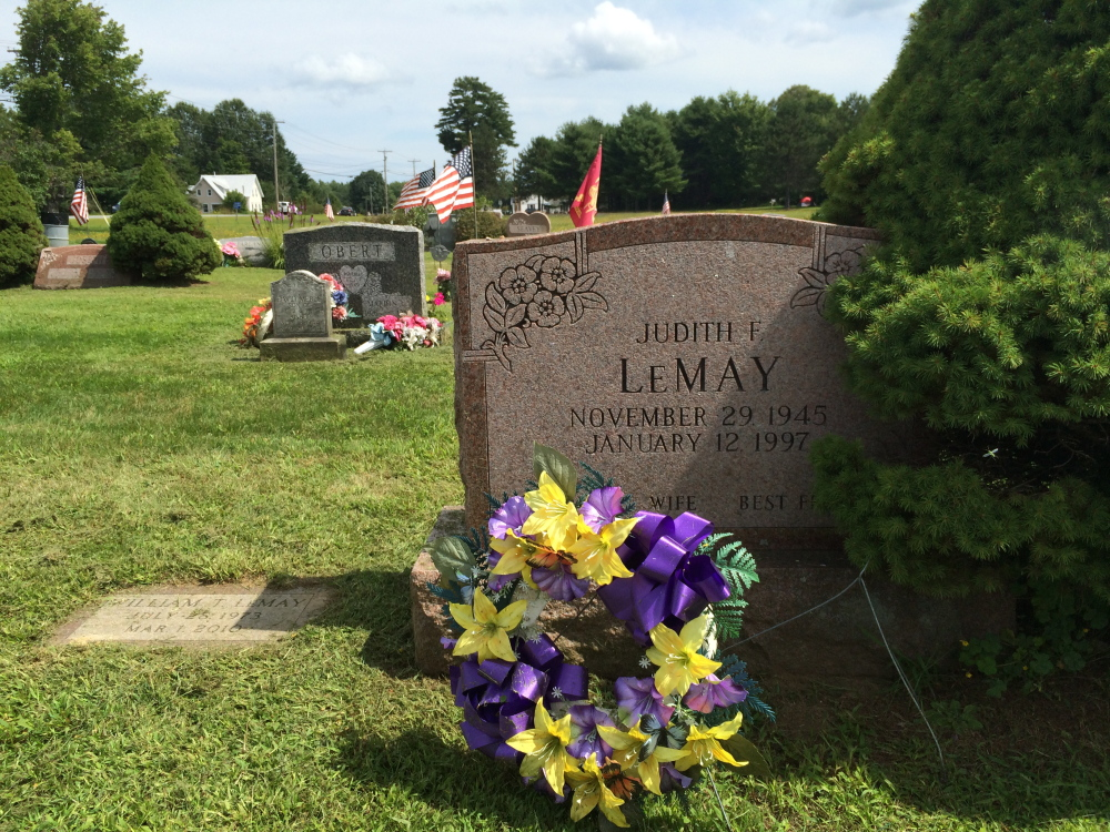 Normal:The gravestone of Judith LeMay straddles the property line dividing two plots in Sunset View Cemetery in Norridgewock. LeMay's father, Kenneth Field, and another family, the Bishops, both have deeds to the plot and have buried remains there.