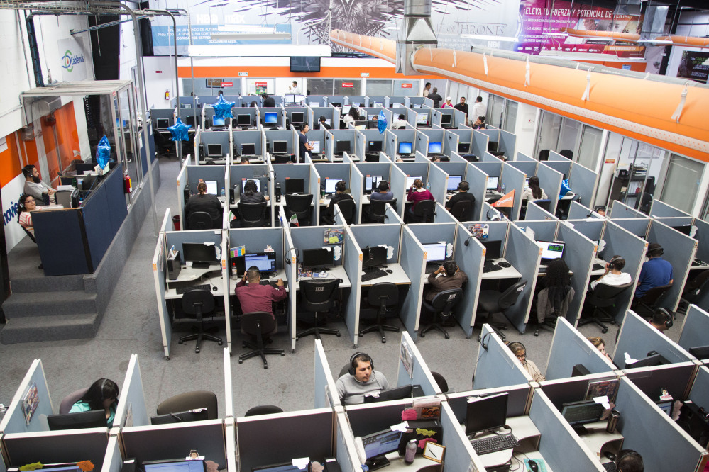 Many Mexicans deported under U.S. President Barack Obama are finding employment in call centers such as the Firstkontact Center, a call center in the northern border city of Tijuana, Mexico.
