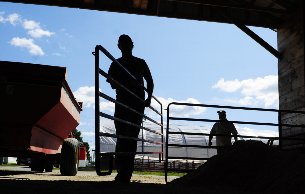 A.J. Larrabee, left, and John Perkins move fence sections around a sheep barn on Tuesday as they set up for the Windsor Fair that opens Sunday. The fair runs from Sunday through Sept. 1 at the Windsor Fair Grounds on Ridge Road (Route 32).