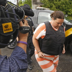 St. Lawrence County Sheriff's deputies escort Nicole Vaisey, 25, into Fowler Town Court on Thursday in Fowler, N.Y. Vaisey and Stephen Howells II are charged with abducting and sexually abusing two young Amish sisters.