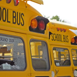 A broken rear window is seen Saturday on a school bus parked beside Monmouth Academy.