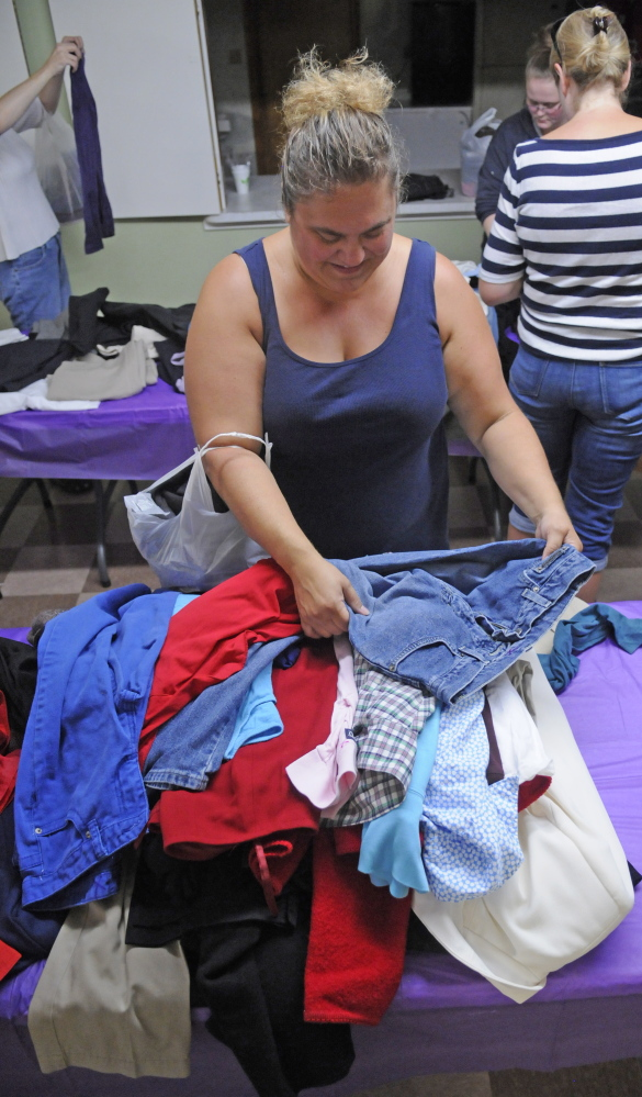 Tricia Hawk, of Vassalboro, looks for items during a clothing giveaway Saturday at Kennebec Community Church in Augusta.