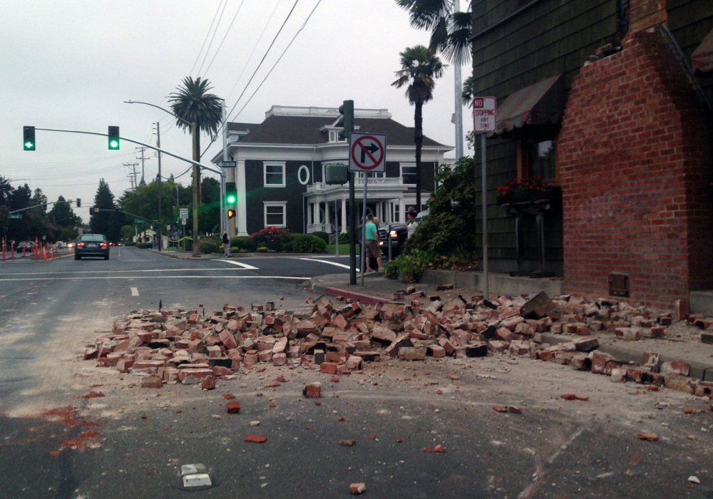 Bricks are in the street after a building was damaged during an earthquake in Napa, Calif., on Sunday.