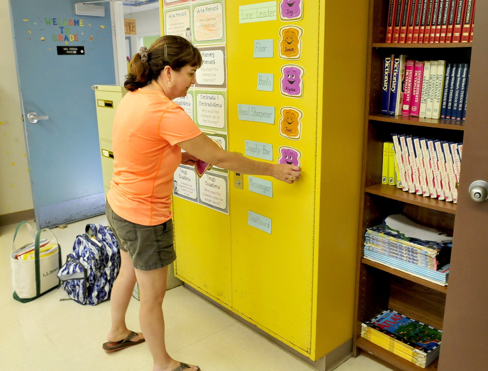 Athens Community School teacher Sandy Perkins readies her classroom for the upcoming school year which begins Thursday.