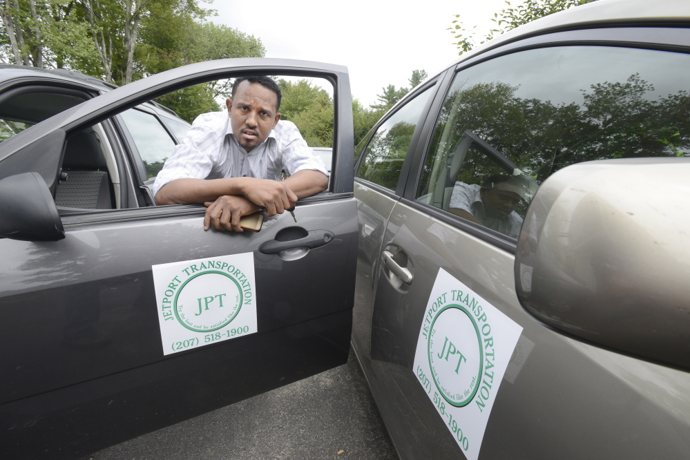 Ilyas Sharif, here at home in Westbrook, owns a fleet of taxis and holds a jetport permit.
