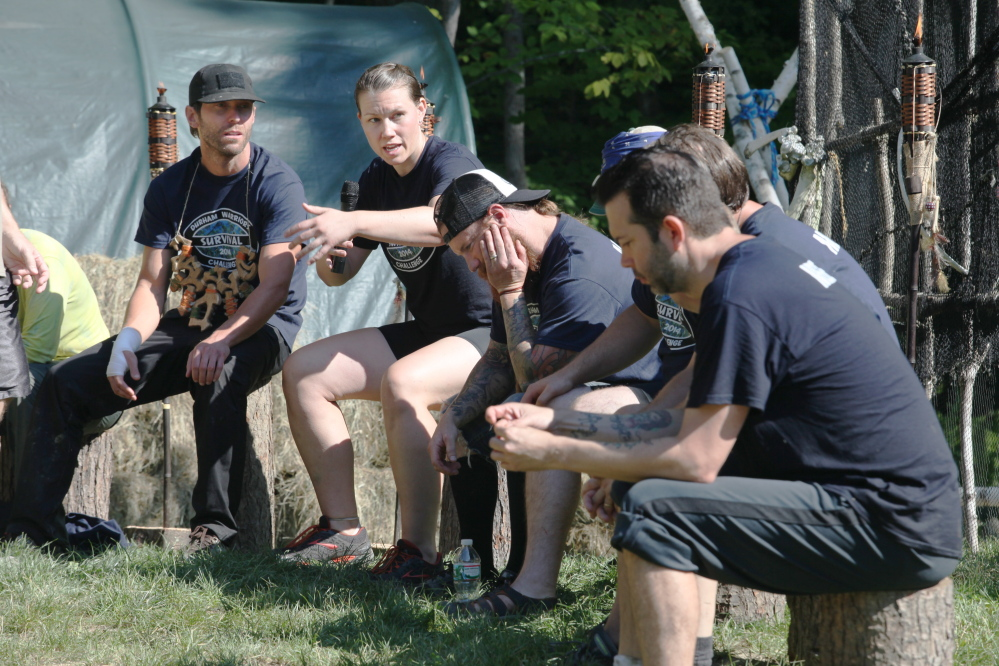 "Rebecca Brakeley, of Portland, speaks Sunday during a Tribal Council as part of the 2nd annual Durham Warriors Survival Challenge in Durham. The fundraiser is put on by ""Survivor"" winner Bob Crowley."