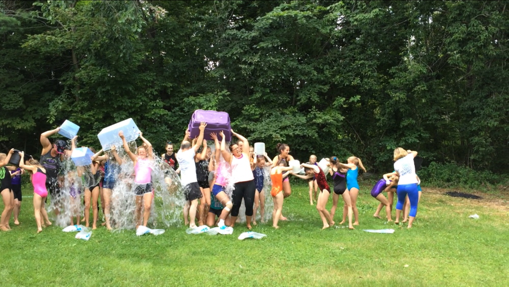 Gymnasts and coaches at Maine-ly Gymnastics in Augusta taking part in the ice bucket challenge for ALS. The gym has called out called out Olympic gymnast Jordan Weber.