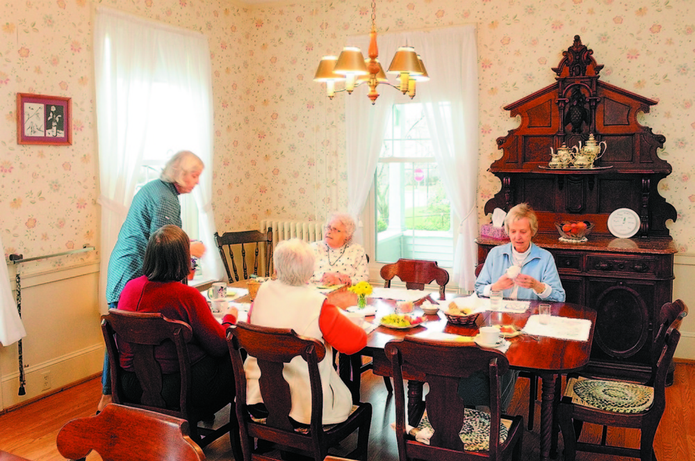 Women enjoy daily afternoon tea at St. Mark's Home in Augusta in this 2011 photo. Some of the furniture in the dining room is from the home's original owner, Alan Lambard, who died in 1877.
