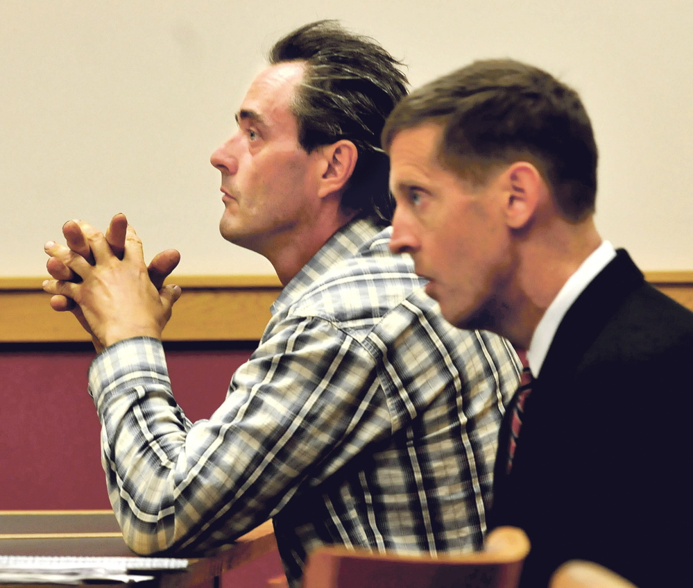 Defendant Robert Dale, left, and his attorney, Walter McKee, listen to testimony during a hearing at Skowhegan District Court Monday. Dale is facing a charge of contempt for not cleaning up his Maine 201 Antiques business in Fairfield as ordered by the town.