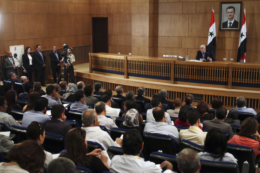 Syrian Foreign Minister Walid al-Moallem speaks during a press conference, giving the first public comments by a senior Assad official on the threat posed by the Islamic State group, in Damascus, Syria on Monday.