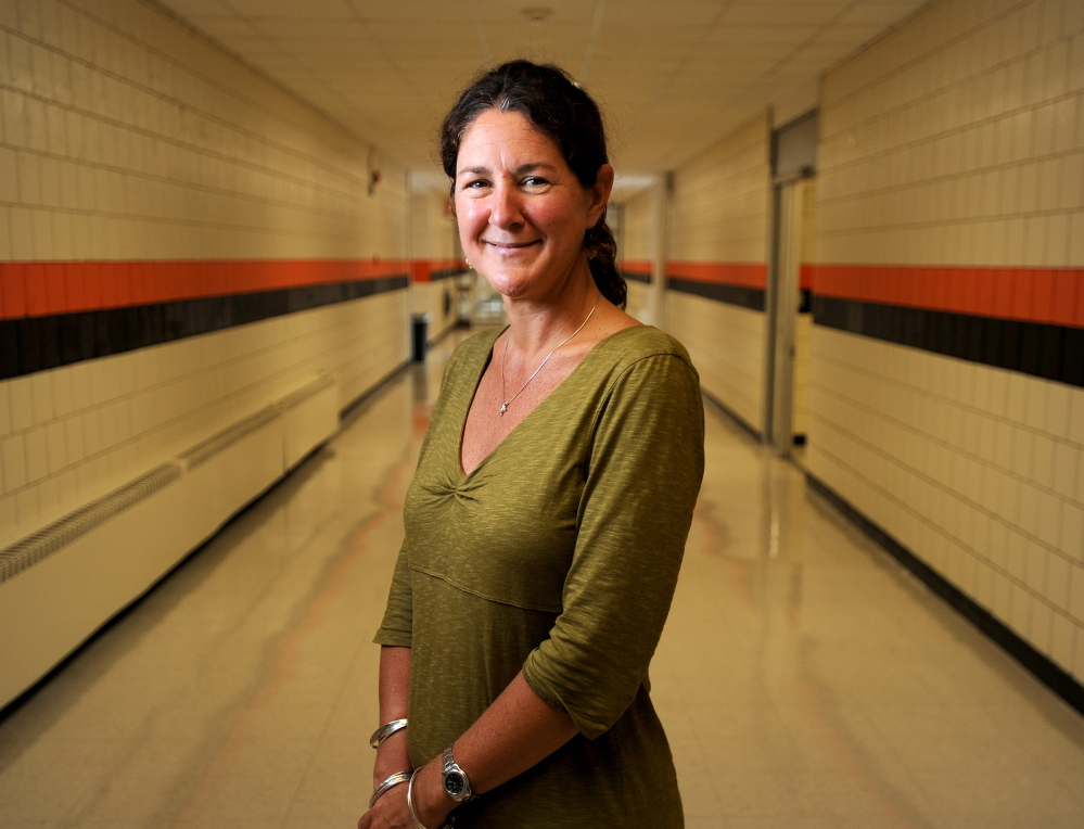 Monique Poulin is the new Skowhegan Area High School principal. Poulin stands in a hallway at Skowhegan Area High School just before the beginning of her first year as principal.