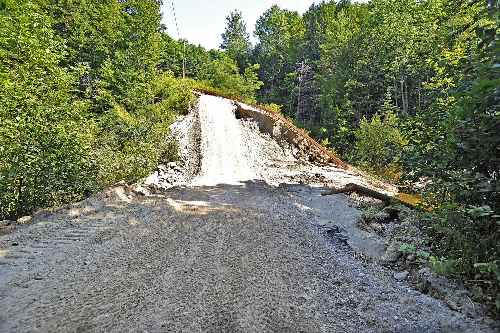 This private road in Freeport, shown Tuesday, used to be 15 to 20 feet higher but was washed out in the latest storm. It is partially usable after a construction crew put in a culvert and added tons of fill to make it passable. The cost of a complete repair is estimated to be $85,000, according to Arleen Siegert-Young, who uses it as the only way to reach to her home.